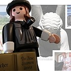 Playmobil-Luther mit Fotokamera.